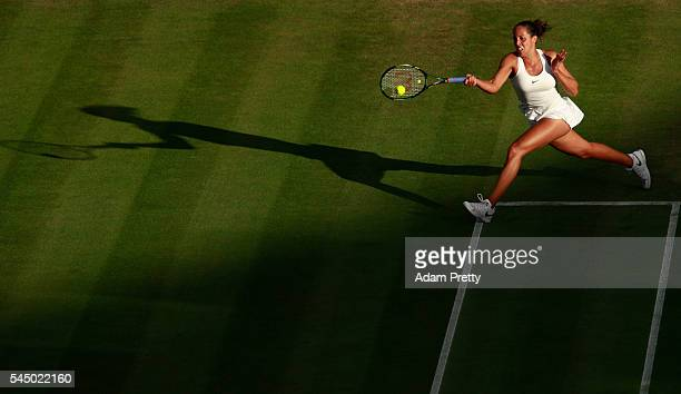Madison Keys of The United States plays a return during the Ladies Singles third round match against Alize Cornet of France on day six of the...