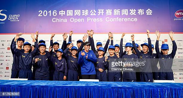 Madison Keys of the United States poses for a picture with the ball kids on day six of the 2016 China Open at the China National Tennis Centre on...