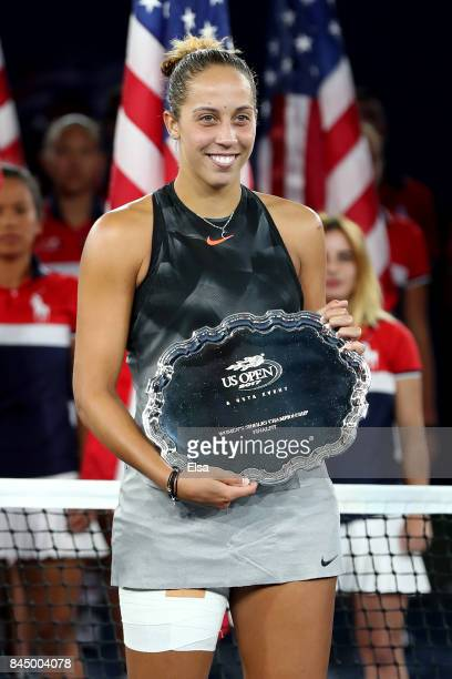 Madison Keys of the United States poses with the runnersup trophy during the trophy presentation after the Women's Singles finals match on Day...