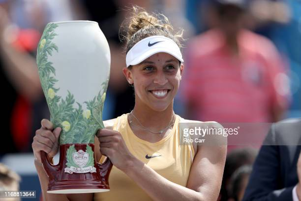 Madison Keys of the United States poses with the trophy after defeating Svetlana Kuznetsova of Russia during the Women's Final of the Western and...
