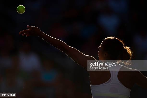 TOPSHOT Madison Keys of the United States releases the ball to serve during her Rogers Cup semi final match against Kristina Kucova of Slovakia at...