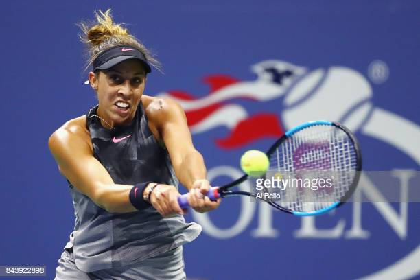 Madison Keys of the United States returns a shot against CoCo Vandeweghe of the United States during her Women's Singles Semifinal match on Day...