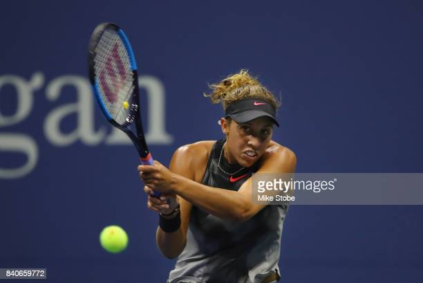 Madison Keys of the United States returns a shot to Elise Mertens of Belgium during their round one Women's Singles match on Day Two during the 2017...