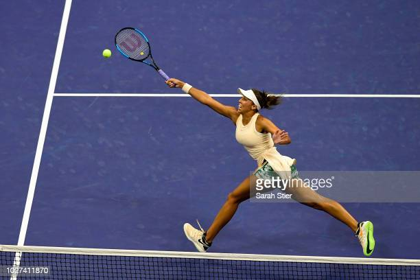 Madison Keys of the United States returns the ball during her women's singles quarterfinal match against Carla Suarez Navarro of Spain on Day Ten of...