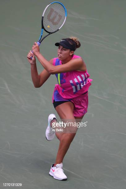 Madison Keys of the United States returns the ball during her Women's Singles first round match against Timea Babos of Hungary on Day Two of the 2020...