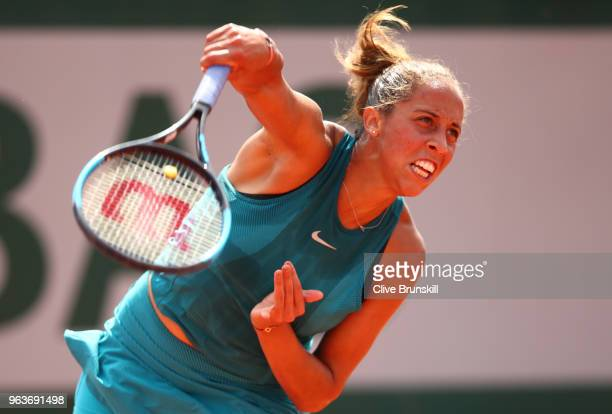 Madison Keys of The United States serves during the ladies singles second round match against Caroline Dolehide of The United States during day four...