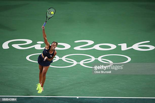 Madison Keys of the United States serves during the women's singles semifinal match against Angelique Kerber of Germany on Day 7 of the Rio 2016...
