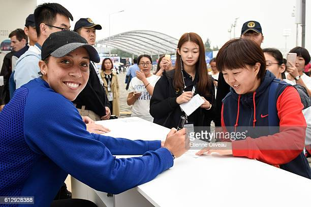 Madison Keys of the United States signs autographs at the USANA booth on day six of the 2016 China Open at the China National Tennis Centre on...