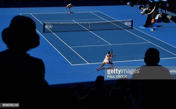 TOPSHOT Madison Keys of the US hits a return against France's Caroline Garcia during their women's singles fourth round match on day eight of the...