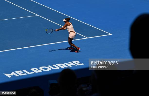 Madison Keys of the US hits a return against France's Caroline Garcia during their women's singles fourth round match on day eight of the Australian...