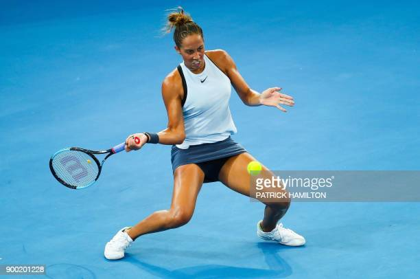 TOPSHOT Madison Keys of the US hits a return against Johanna Konta of Britain during their first round women's singles match at the Brisbane...