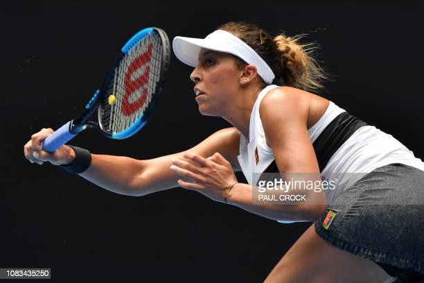 Madison Keys of the US hits a return against Russia's Anastasia Potapova during their women's singles match on day four of the Australian Open tennis...