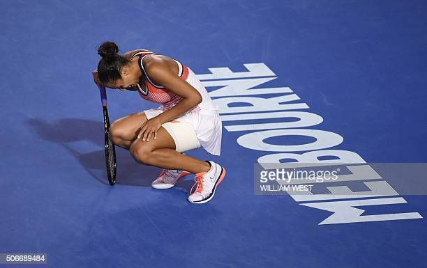 Madison Keys of the US leans on her injured leg during her women's singles match against China's Zhang Shuai on day eight of the 2016 Australian Open...