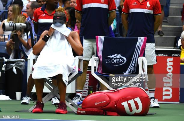 Madison Keys of the US pauses between sets during her match against compatriot Sloane Stephens in their women's finals match of the US Open 2017 at...