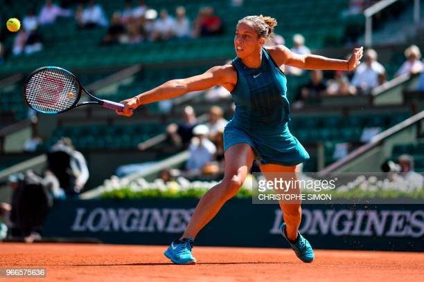 Madison Keys of the US plays a backhand return to Romania's Mihaela Buzarnescu during their women's singles fourth round match on day eight of The...