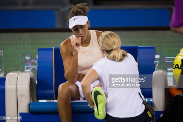 Madison Keys of the US receives medical treatment as she plays against Angelique Kerber of Germany during their women's singles third round match of...