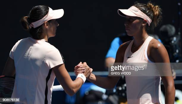 Madison Keys of the US shakes hands with France's Caroline Garcia after their women's singles fourth round match on day eight of the Australian Open...