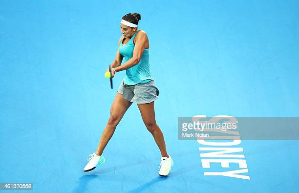 Madison Keys of the USA plays a backhand in her match against Svetlana Kuznetsova of Russia during the day one of the 2015 Sydney International at...