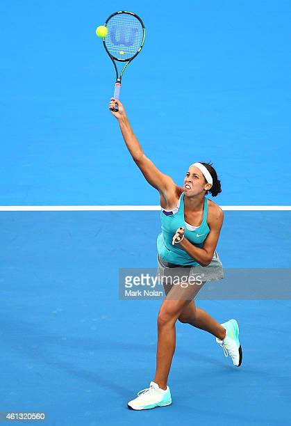 Madison Keys of the USA plays an overhead smash in her match against Svetlana Kuznetsova of Russia during the day one of the 2015 Sydney...