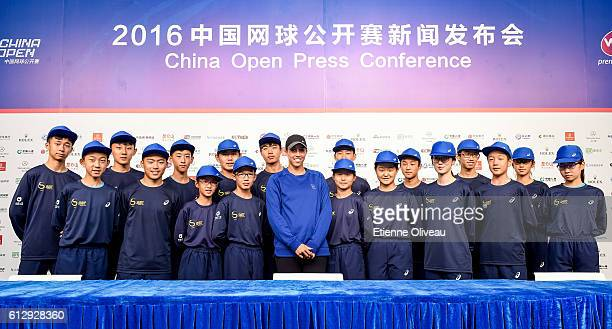 Madison Keys of United States poses for a picture with the ball kids on day six of the 2016 China Open at the China National Tennis Centre on October...
