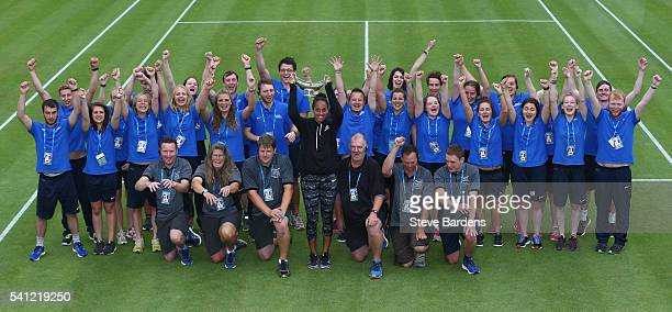 Madison Keys of United States poses with the Maud Watson trophy and the ground staff on day seven of the WTA Aegon Classic at Edgbaston Priory Club...