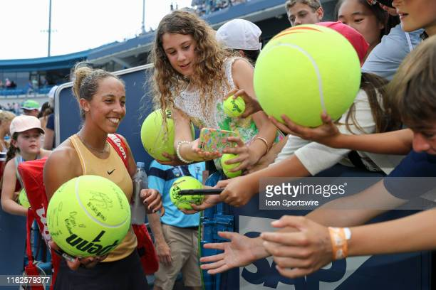 Madison Keys of United States signs autographs and poses for photos with fans after winning the Western Southern Open at Lindner Family Tennis Center...