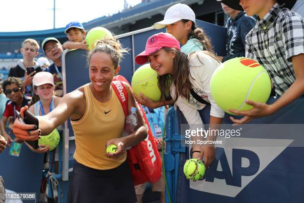 Madison Keys of United States signs autographs and takes a selfie with a fans phone after winning the Western Southern Open at Lindner Family Tennis...