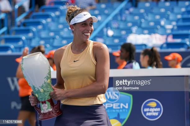 Madison Keys of United States smiles as she poses with the Rookwood Cup trophy after winning the Western Southern Open at Lindner Family Tennis...