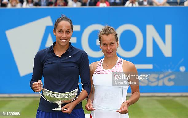 Madison Keys of United States with the Maud Watson trophy and Barbara Strycova of Czech Republic after the Women's Singles Final on day seven of the...