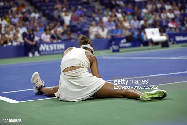 TOPSHOT Madison Keys of US falls down after hitting a return to Pauline Parmentier of France during their 2018 US Open women's match in New York on...