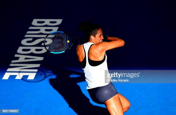 Madison Keys of USA plays a forehand in her match against Johanna Konta of Great Britain during day two of the 2018 Brisbane International at Pat...