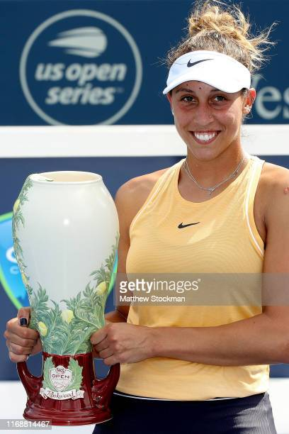 Madison Keys poses for photographers after defeating Svetlana Kuznetsova of Russia in the women's final during the Western Southern Open at Lindner...