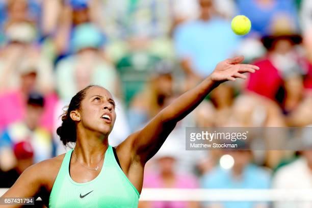 Madison Keys serves to Viktorija Golubic of Switzlerland during the Miami Open at the Crandon Park Tennis Center on March 24 2017 in Key Biscayne...