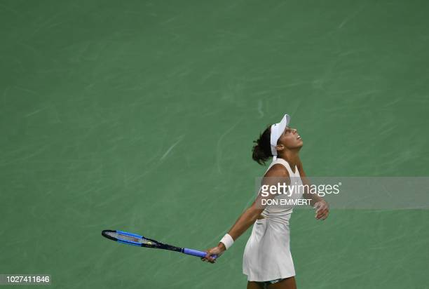 Madison Keys watches a missed hit ball fly off the court while playing against Spain's Carla Suarez Navarro during their Women's Singles...