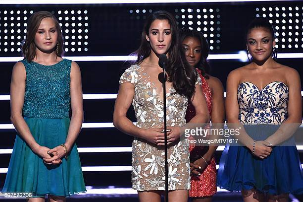 Madison Kocian Aly Raisman Simone Biles and Laurie Hernandez present Best Female Video onstage during the 2016 MTV Video Music Awards at Madison...