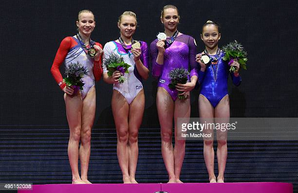 Madison Kocian of United States Daria Spiridonova of Russia Viktoriia Komova of Russia and Fan Yilin of China all stand on the podium with their gold...