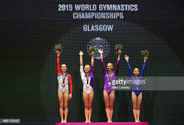 Madison Kocian of USA Daria Spiridonova of Russia Viktoriia Komova and Yilin Fan of China all win Gold in the Uneven Bars Final during day nine of...