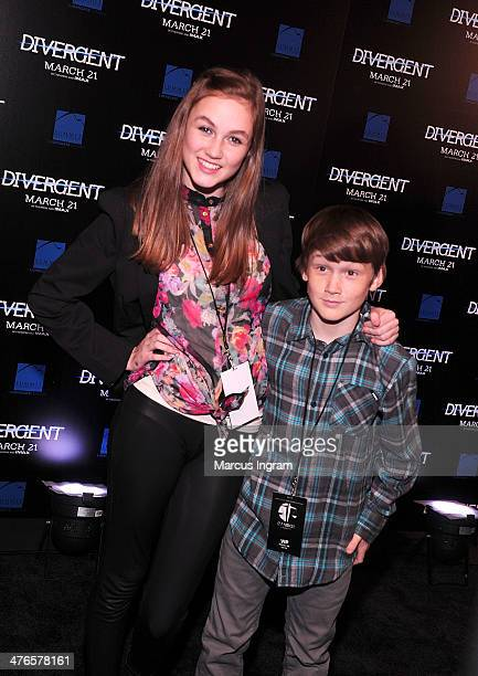 Madison Lintz and Matthew Lintz attends the Divergent screening at Regal Atlantic Station on March 3 2014 in Atlanta Georgia