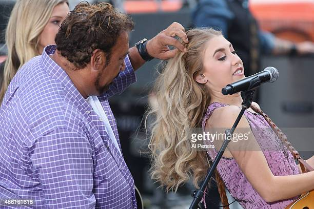 Madison Maddie Marlow of Maddie Tae has her hair adjusted when she performs on NBC's Today Show at Rockefeller Plaza on September 1 2015 in New York...