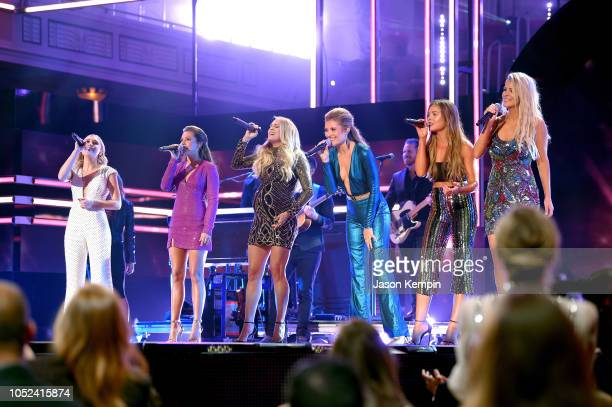 Madison Marlow Taylor Dye Carrie Underwood Hannah Mulholland Naomi Cooke and Jennifer Wayne onstage during the 2018 CMT Artists of The Year at...