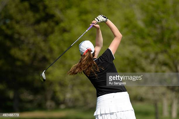 Madison McCambridge of Fairview High School tees off of hole two at Raccoon Creek Golf Course in Littleton May 20 2014 McCambridge joined other class...