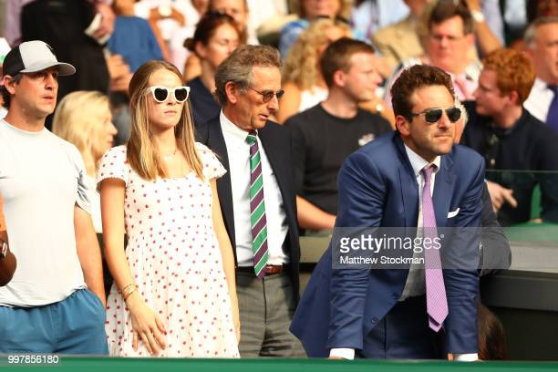 Madison McKinley and Justin Gimelstob watch the Men's Singles semifinal match between John Isner of The United States and Kevin Anderson of South...