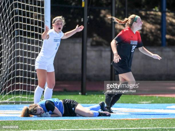 Madison midfielder Julia Leas celebrates after beating Yorktown goalie Sydney Davis for the loose ball after colliding near the goal with defender...