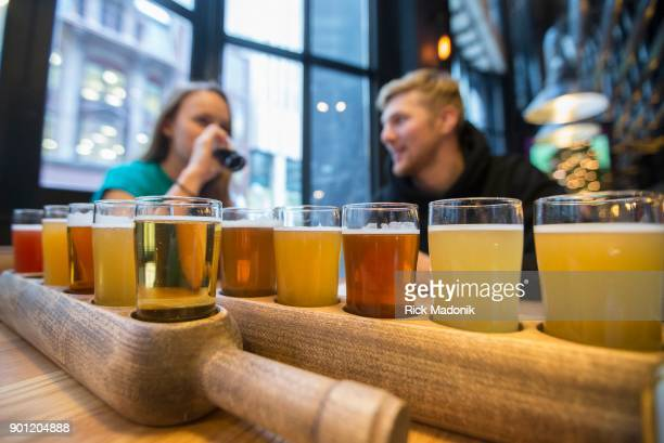 Madison Peters and Ed Matthews try a two different Six Pack Samplers of various beers available The Craft Beer Market recently opened at 1 Adelaide...