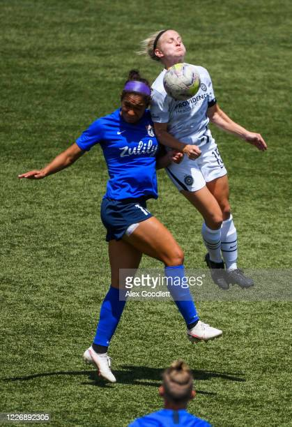 Madison Pogarch of Portland Thorns FC fights for the ball with Darian Jenkins of OL Reign during a game on day 8 of the NWSL Challenge Cup at Zions...
