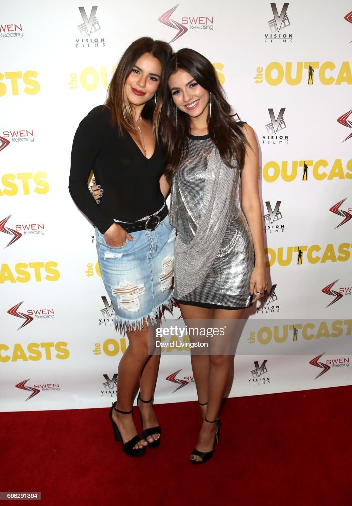Madison Reed (L) and actress Victoria Justice attend the premiere of Swen Group's 'The Outcasts' at Landmark Regent on April 13, 2017 in Los Angeles, California.
