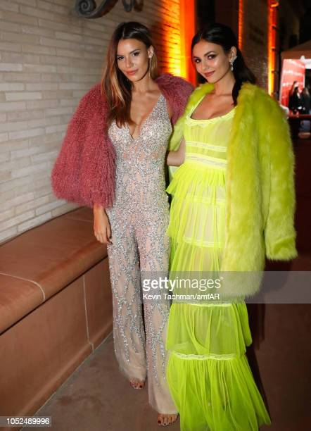 Madison Reed and Victoria Justice attend the amfAR Gala Los Angeles 2018 at Wallis Annenberg Center for the Performing Arts on October 18 2018 in...