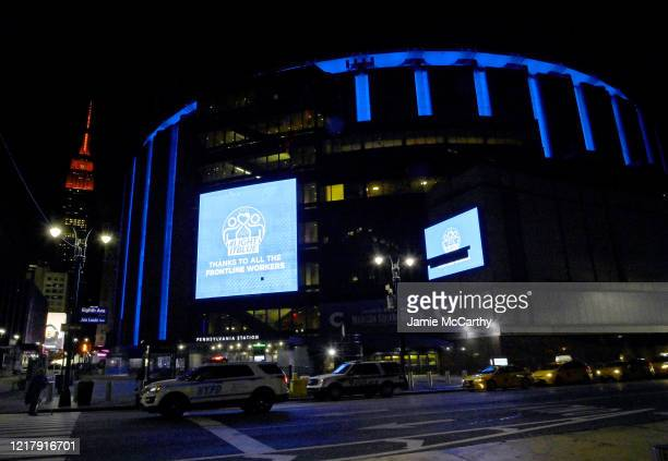 Madison Square Garden is illuminated in blue lights on April 09, 2020 in New York City. Landmarks and buildings across the nation are doing the same...