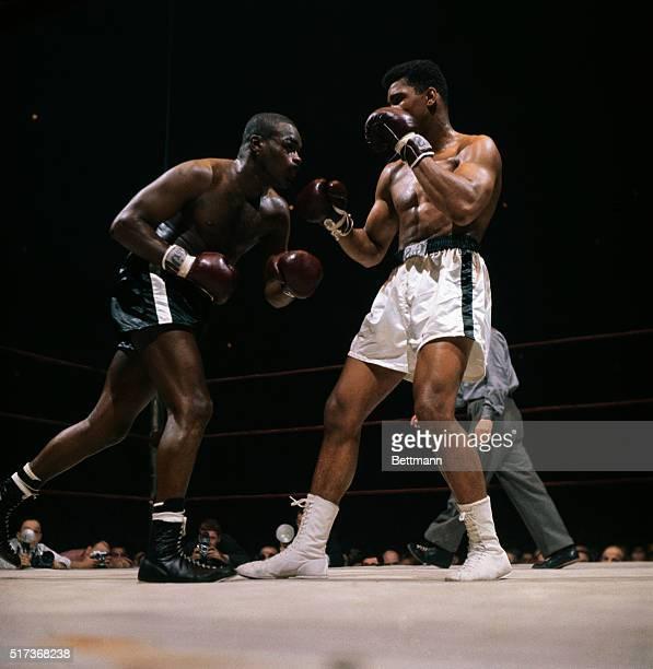 Cassius Clay fight action with Doug Jones