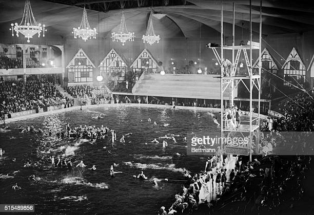 Madison Square Garden transformed into swimming pool scene in Tex Rickard's luxurious indoor swimming pool which was thrown open to the public June...